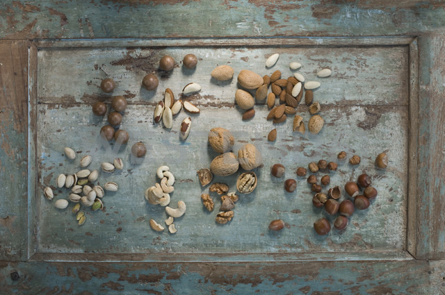 Different sorts of nuts on wood - ASF005822