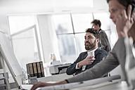 Man at desk having a coffee break - ZEF008163
