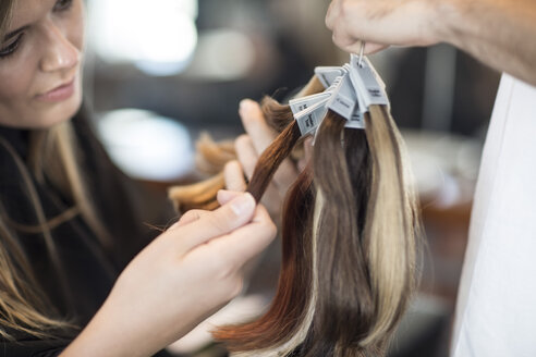 Woman in hair salon chooing new hair color - ZEF008199