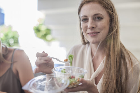 Young businesswoman eating salad for lunch - ZEF008244