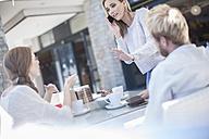 Friends meeting in outdoor cafe - ZEF008274