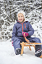 Portrait of girl sledging in the forest - VTF000498