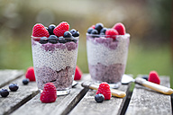 Two glasses of chia pudding with blueberries and raspberries - SARF002514