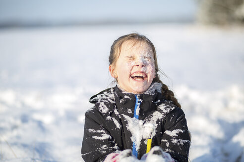 Portrait of laughing girl with snow-covered face - ASCF000483