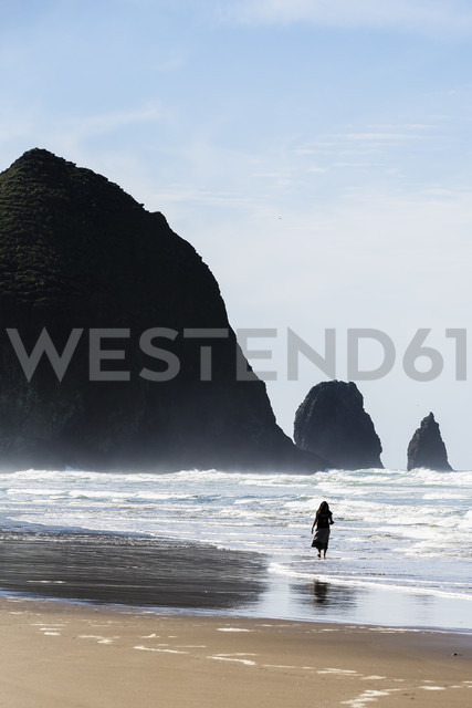 USA, Oregon, Cannon Beach, Haystack Rock, woman on the beach - NGF000264