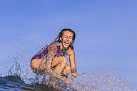 Indonesia, Bali, surfing young woman - KNTF000234