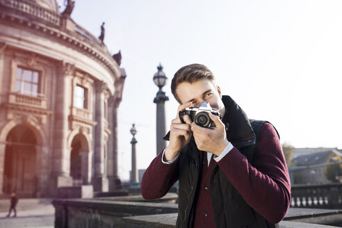 Germany, Berlin, young man taking picture at Bode Museum - GCF000138
