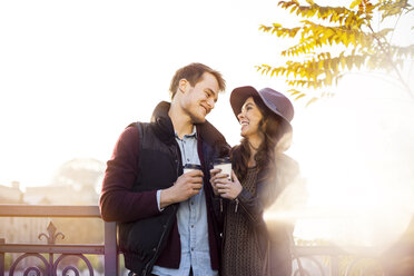 Smiling young couple with coffee to go - GCF000174