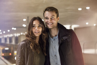 Germany, Berlin, smiling couple in underground station - GC000189