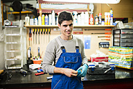 Portrait of a mechanic in his workshop - RAEF000834