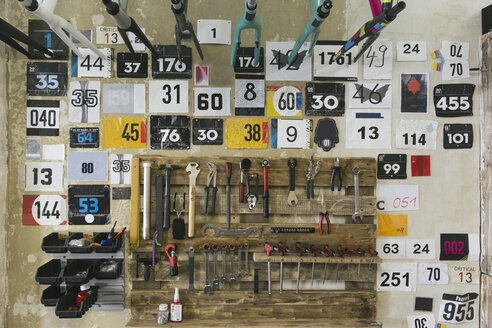 Numbers and tools hanging at the wall in a workshop - JUBF000108
