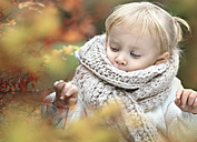 Portrait of little blond girl wearing big scarf in autumn - NIF000077