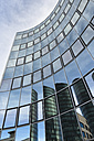 Germany, Stuttgart Vaihingen, reflections on glass facade of an office tower - FCF000840