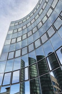 Germany, Stuttgart Vaihingen, reflections on glass facade of an office tower - FCF000840