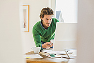 Young man working at home office - UUF006506