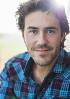 Portrait of man with brown hair wearing checked shirt - UUF006518