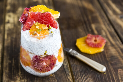 Chia Pudding and slices of orange blood orange and grapefruit in glass - SARF002541