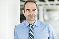 Portrait of confident businessman - UUF006526