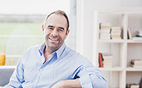 Portrait of smiling businessman at home - UUF006562