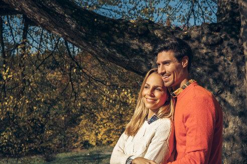Happy couple enjoying autumn forest - CHAF001567