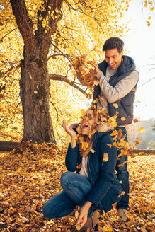 Happy couple having fun in autumn in a forest - CHAF001591