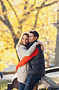 Happy couple enjoying autumn in a park - CHAF001603