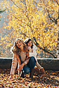Happy mother and her little daughter in autumn - CHAF001642