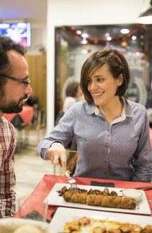 Couple eating in a Spanish bar - JASF000385