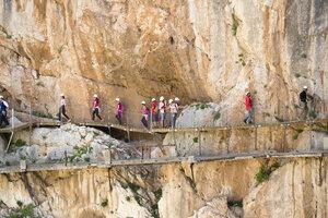 Spain, Ardales, tourists walking along The King's Little Pathway - KIJ000165