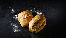Two different wheat rolls on dark ground - KSWF001736