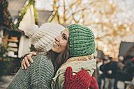 Happy women hugging on the Christmas Market - MFF002656