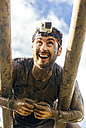 Participants in extreme obstacle race climbing on monkey bars - MGOF001401