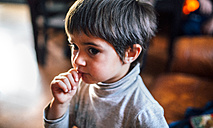 Portrait of little boy with finger in his mouth - MGOF001417