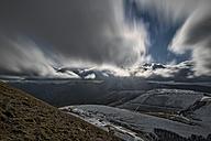 Italy, Umbria, Monti Sibillini National Park, Clouds on plateau Piano Grande of Castelluccio di Norcia - LOMF000213