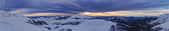 Italy, Umbria, Monti Sibillini National Park, Sunset on Apennines and plateu Piano Grande of Castelluccio di Norcia in Winter - LOMF000216