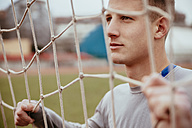 Young man in soccer goal - ZEDF000055