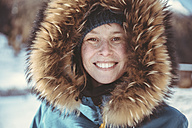 Portrait of happy woman with fur hood - MFF002711