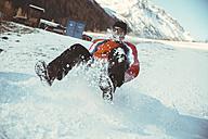 Italy, Val Venosta, Slingia, man sleighing down a snowy hill - MFF002714