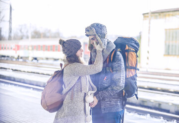 Young couple on station platform - HAPF000210