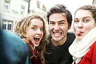 Three playful friends taking a selfie - HAPF000231