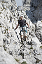 Austria, Tyrol, Wilder Kaiser, man on via ferrata - TKF000434