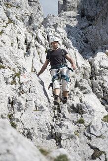 Austria, Tyrol, Wilder Kaiser, man on via ferrata - TKF000434