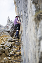 Austria, Tyrol, Wilder Kaiser, man on via ferrata towards Ellmauer Halt - TKF000437