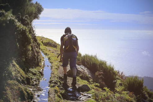Portugal, Madeira, man on hiking trip along the Levadas - REAF000036