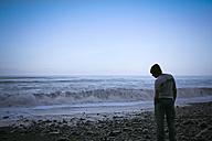 Portugal, Madeira, man on Seixal beach - REAF000054