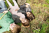 Three kids lying in grass - VABF000142