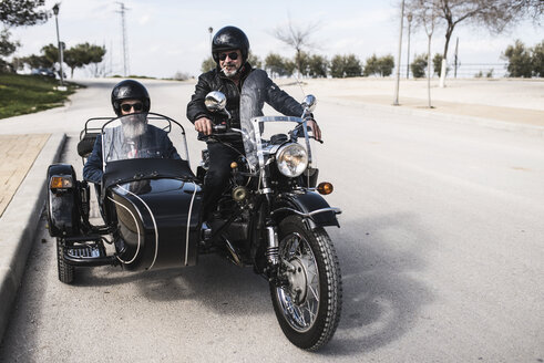 Two bikers standing on a road with their sidecar motorcycle - JASF000406