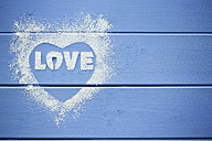Heart shape and the word 'Love' stenciled with icing sugar - MAEF011291