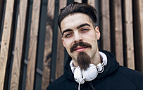 Portrait of stylish young man with headphones - MGOF001434