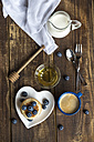 Stack of mini pancakes, blueberries, bowl of honey, milk and a cup of coffee - SARF002550